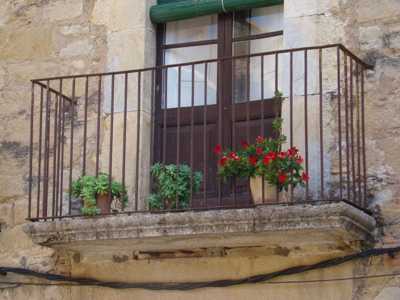 Balconies at  Peratallada Town square