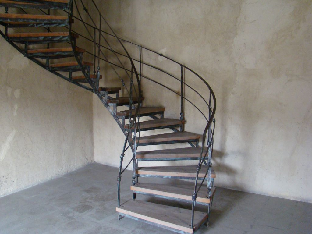 Curved metal stairs heading up to the Georgian Flag