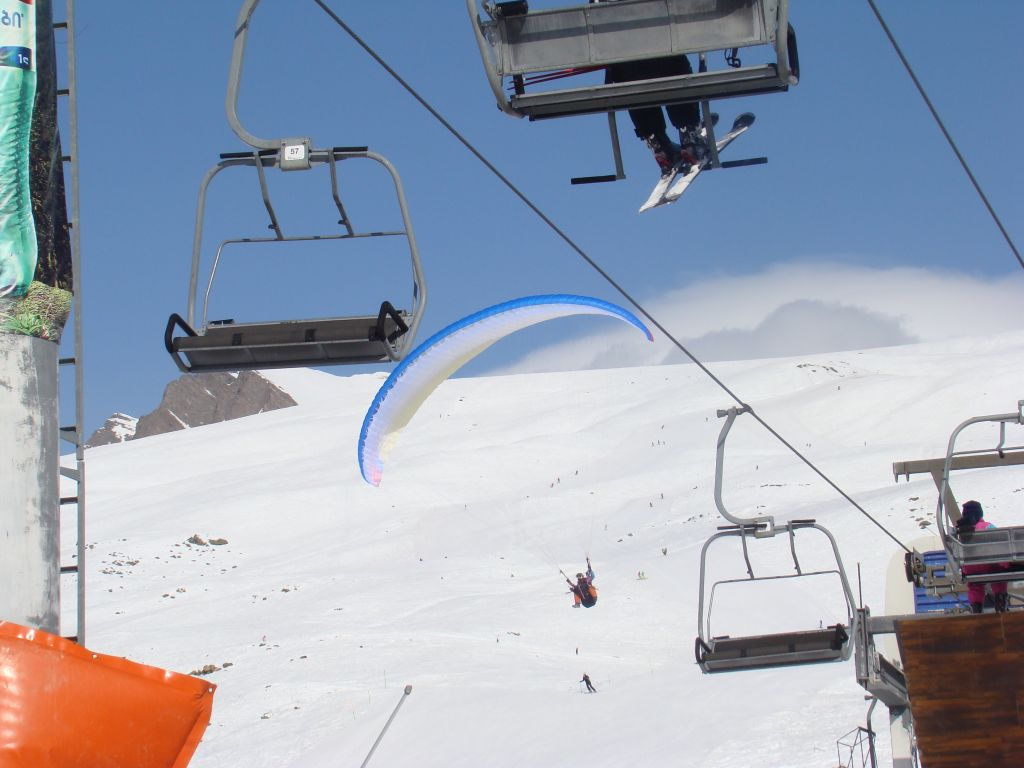 Paragliding - a close landing to ski lifts