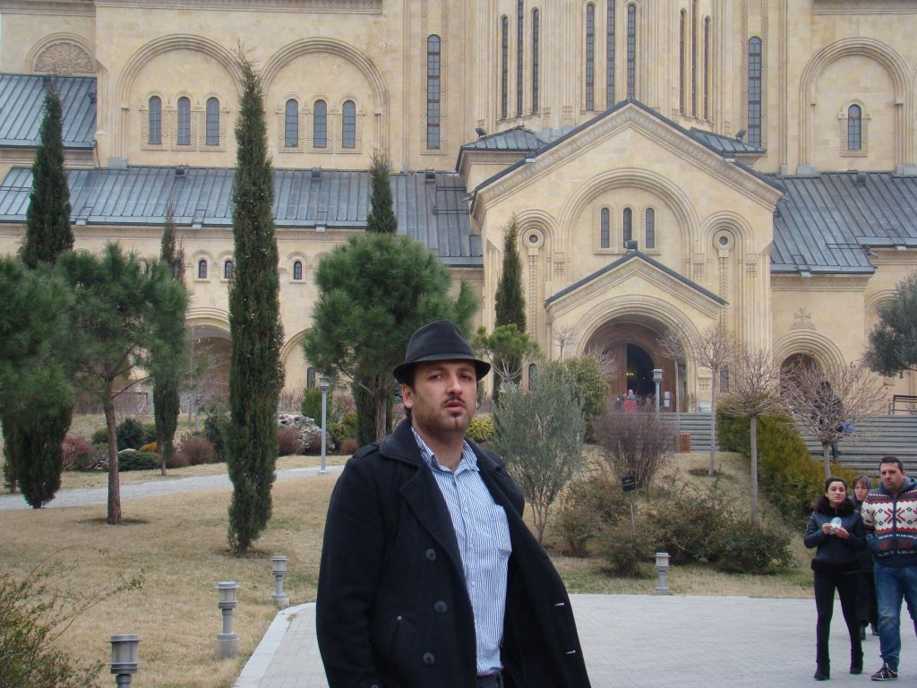 Author of this blog posing next to Sameba cathedral in Tbilisi (2015)