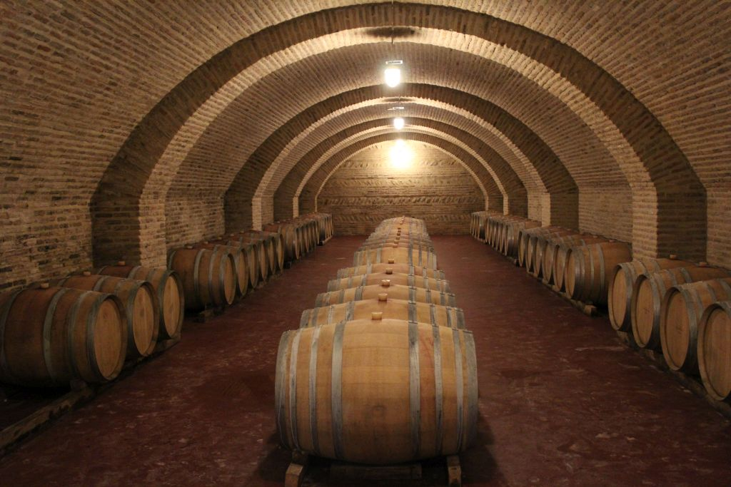 Wine cellars with oak barrels at Château Mukhrani
