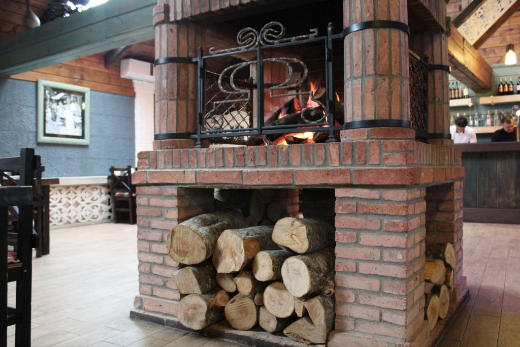 Cosy fireplace at Chashnagiri Natakhtari restaurant