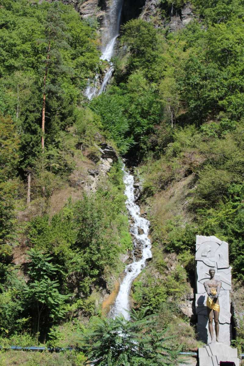 Waterfall and a monument in Borjomi Mineral Water Park