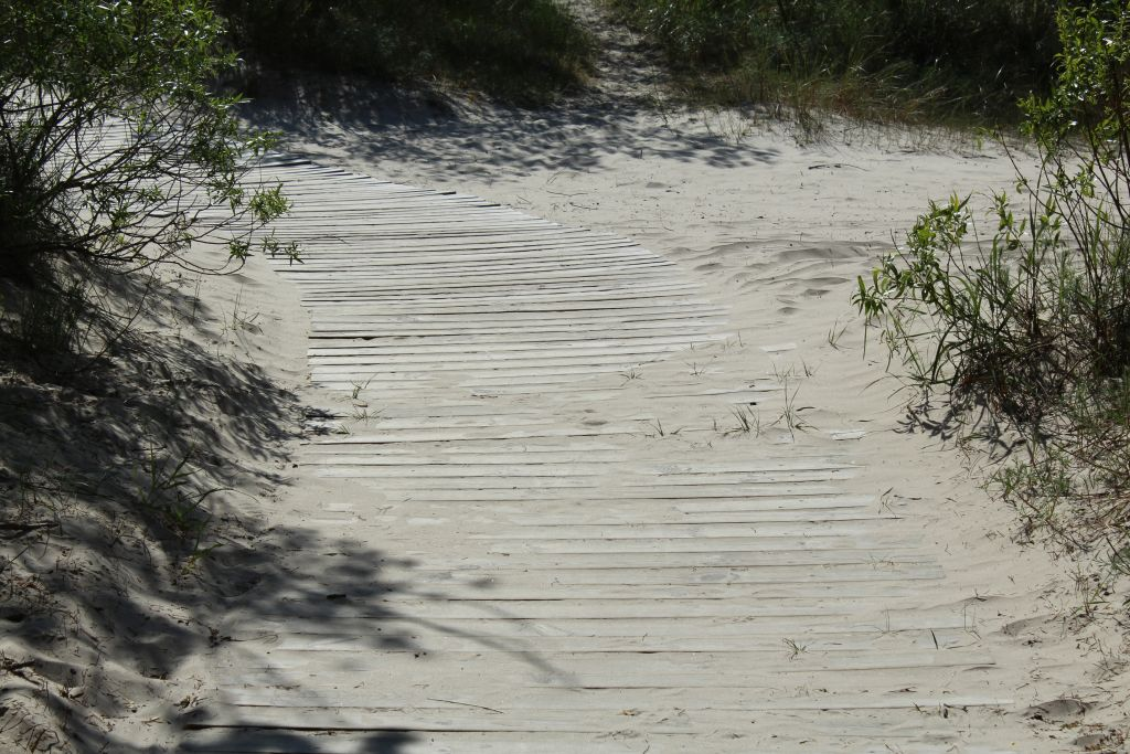 Wooden boardwalk heading to sea in Liepaja