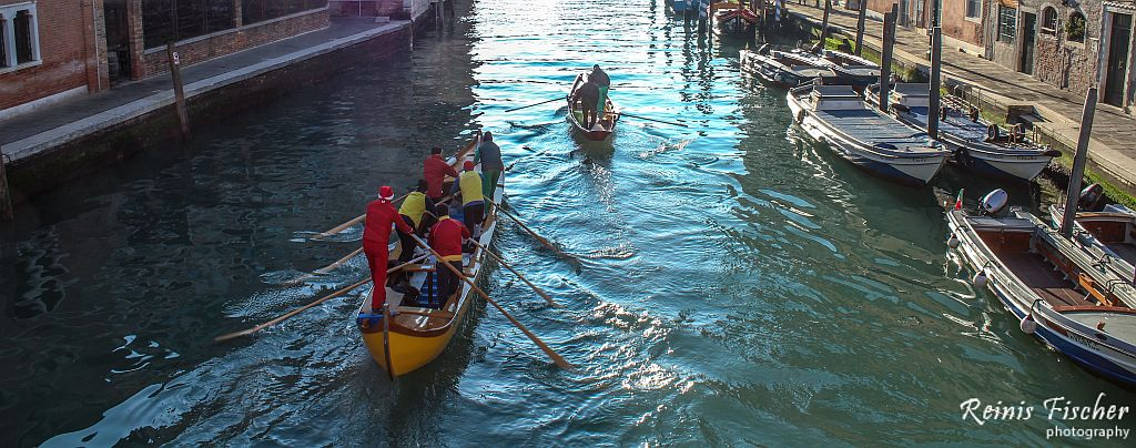 Paddlers on Venice canal