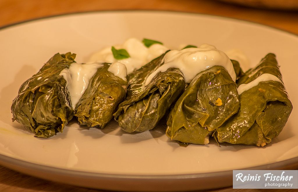 Dolmas dressed with garlic yogurt sauce