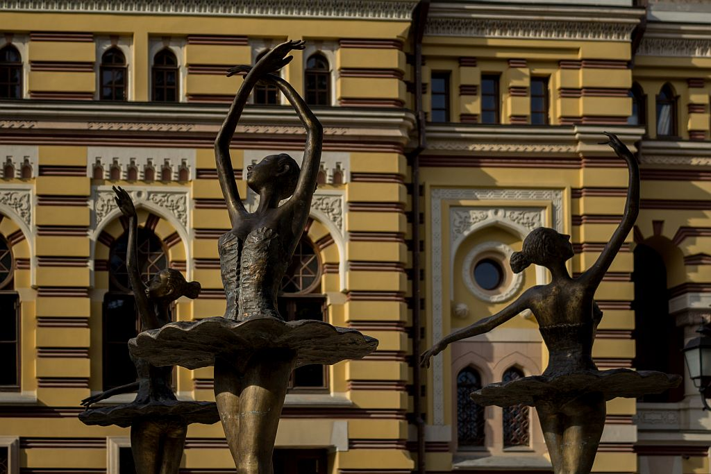 Statue of ballerinas in Opera's park