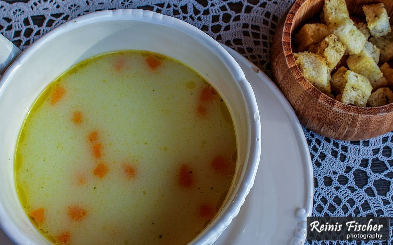 Cheese soup served with croutons
