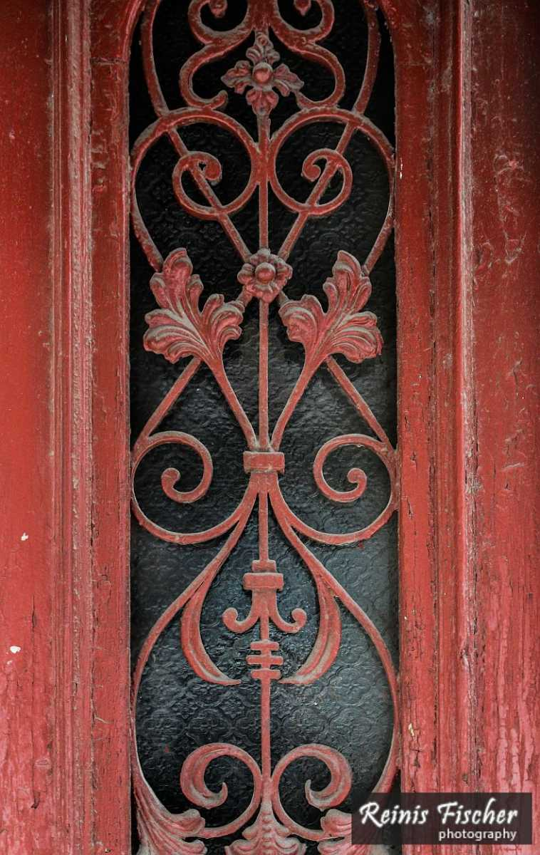 Old metal ornaments in wooden doors