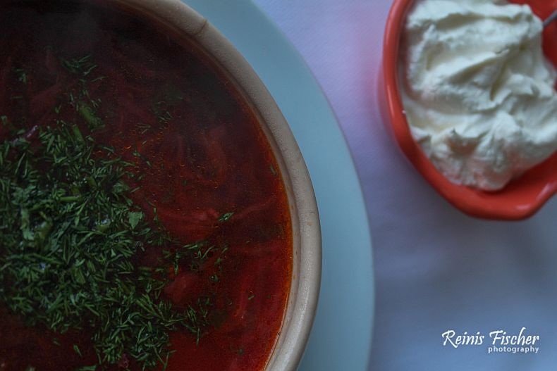 Traditional Ukrainian Borsch served with smetana (sour cream)