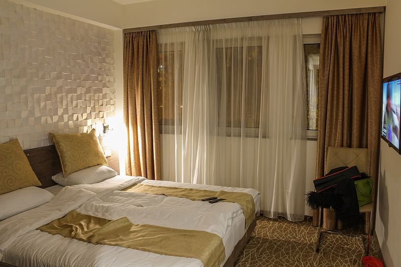 King size bed and flat screen TV at Park hotel in Yerevan