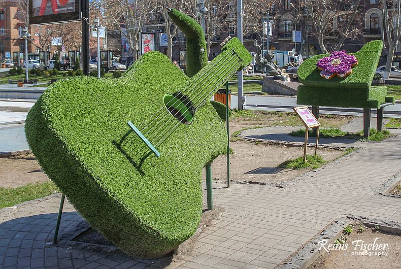 The huge guitar and piano at the entrance of the Swan park