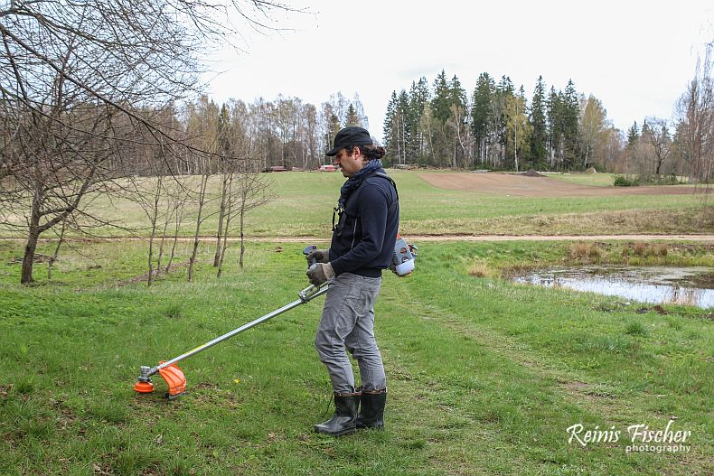 Author of this blog captured in action - trimming grass