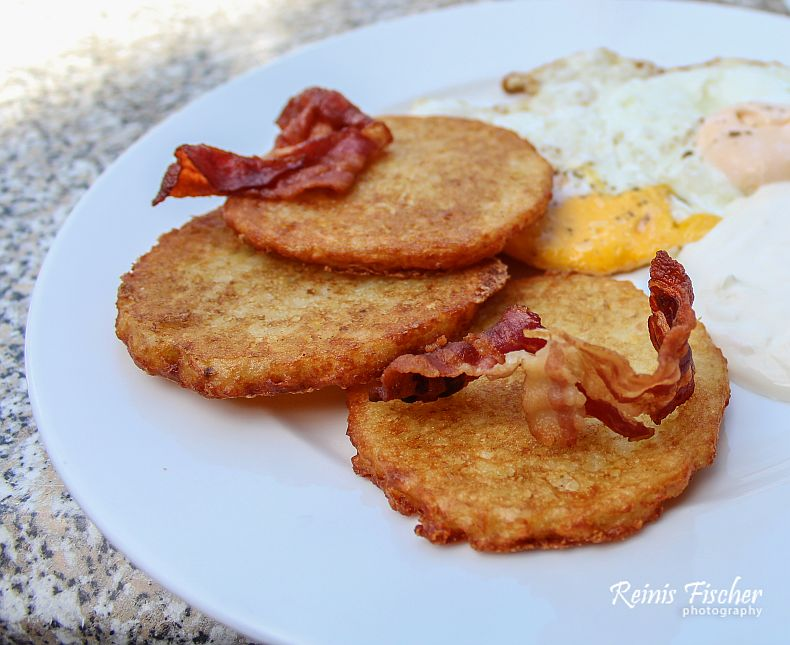 Potato pancakes with sliced bacon