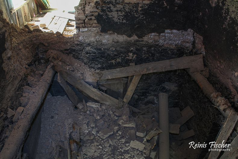 Broken ceiling and chimney
