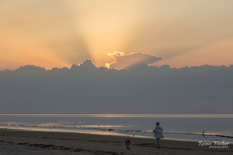 Story telling photo - mother and child in a sunset