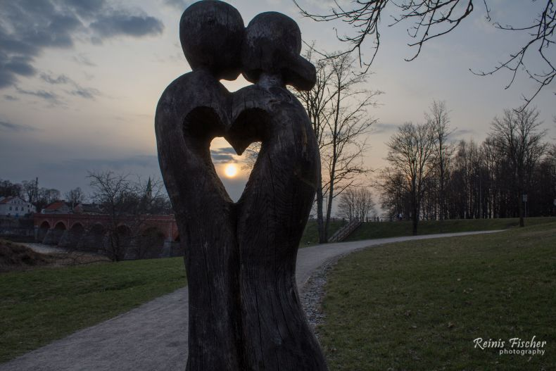 Statue of Love during sunset in Kuldīga