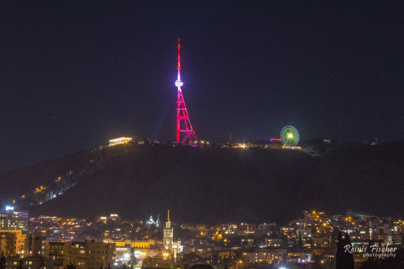 Tbilisi TV tower in the national colors of Latvia