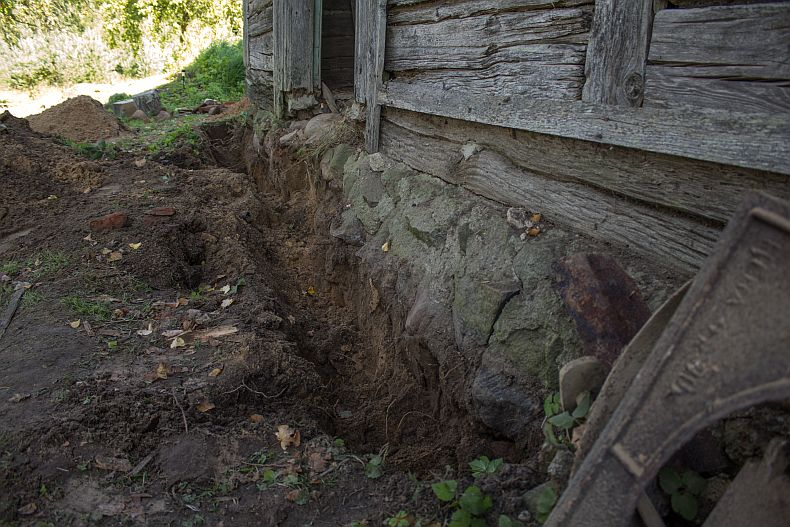 Digging a trench around existing foundation