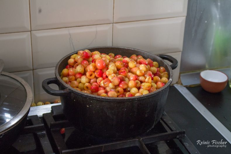 Adding cherries to the syrup water