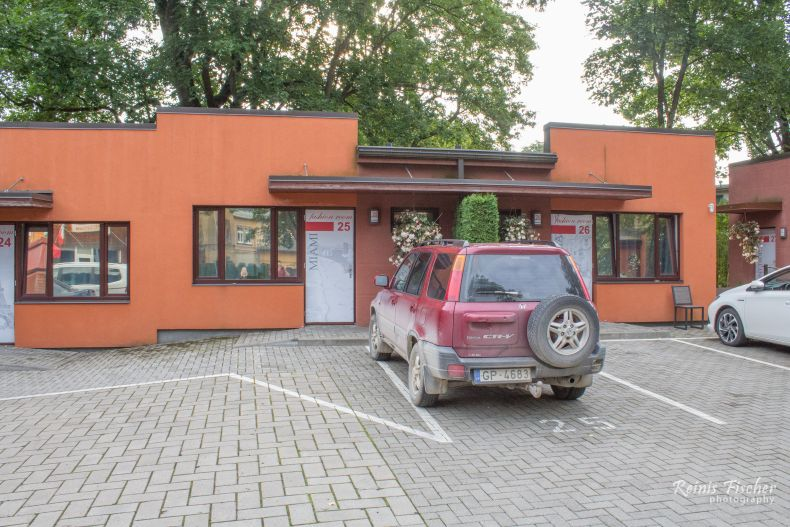 Free parking in front of the motel at Autosole Riga